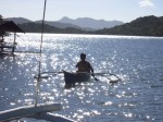 A boat passing us in the glittering waters of Coron bay